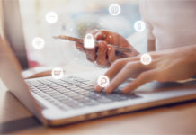 Woman using smartphone and laptop with icon graphic Cyber security network of connected devices and personal data security