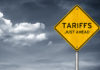 tariffs just ahead road sign