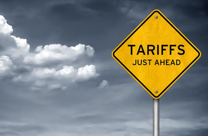 tariffs just ahead road sign
