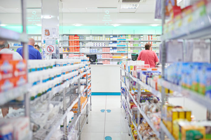 An aisle in a pharmacy. The commercial product(s) or designs displayed in this image represent simulations of a real product, and are changed or altered enough so that they are free of any copyright infringements. Our team of retouching and design specialists custom designed these elements for each photo shoot http://195.154.178.81/DATA/i_collage/pi/shoots/784992.jpg