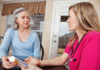 Mature Adult Woman Receiving Medication Instructions From Nurse.