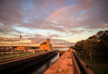 Sault Ste. Marie, Michigan, USA - September 18, 2016: The Soo Locks on the St. Mary's River in Sault Ste. Marie, Michigan framed by a rainbow.