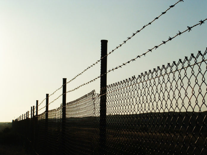 landscape with barbed wire /fence on sunset