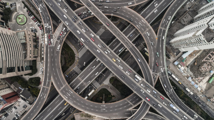 Aerial view of highway infrastructure and overpass in city on a cloudy day