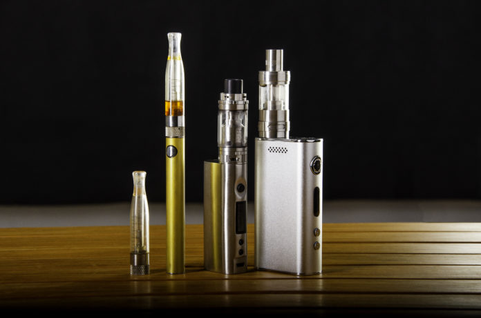 tobacco products, vape products, and e-cigarette on black background