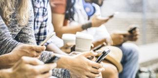 people on phones drinking coffee